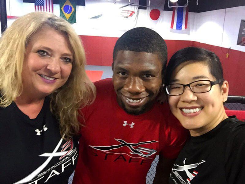 Selfie of Nate with #TeamX3 marketing Tammi & Nancy