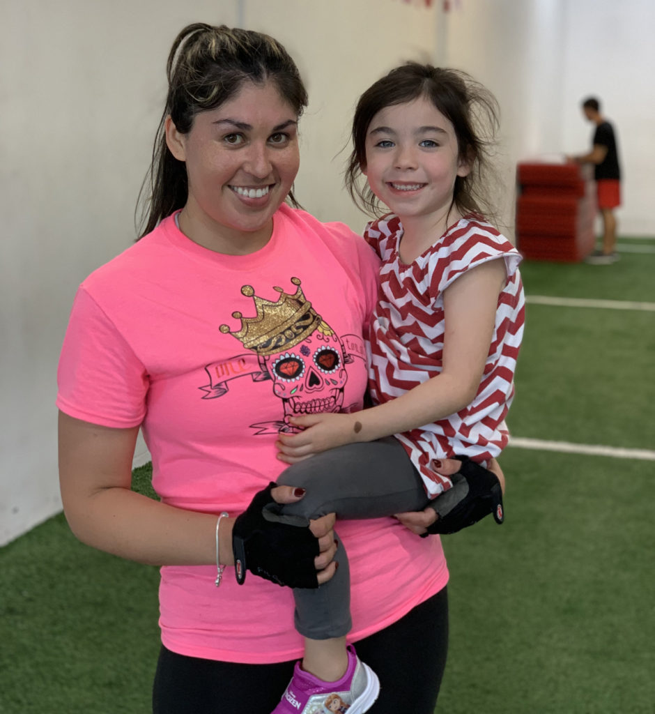 Aracely hanging out with her daughter after a Fast Track bootcamp class at X3 Sports North Marietta location.
