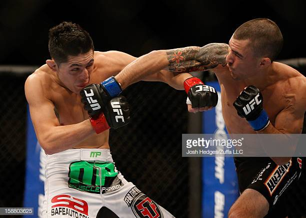 (Training spotlight at x3sports) LAS VEGAS, NV - DECEMBER 29:  Byron Bloodworth (right) punches Erik Perez during their bantamweight fight at UFC 155 on December 29, 2012 at MGM Grand Garden Arena in Las Vegas, Nevada. (Photo by Josh Hedges/Zuffa LLC/Zuffa LLC via Getty Images)