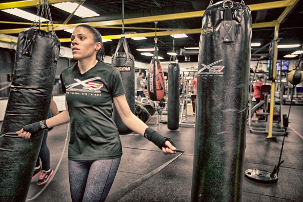woman jumping rope in boxing gym | 7 Benefits Cardio Kickboxing Has On Your Health | X3 Sports