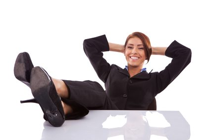 Happy business woman with feet on desk | improved mental health |  7 Benefits Cardio Kickboxing Has On Your Health | X3 Sports