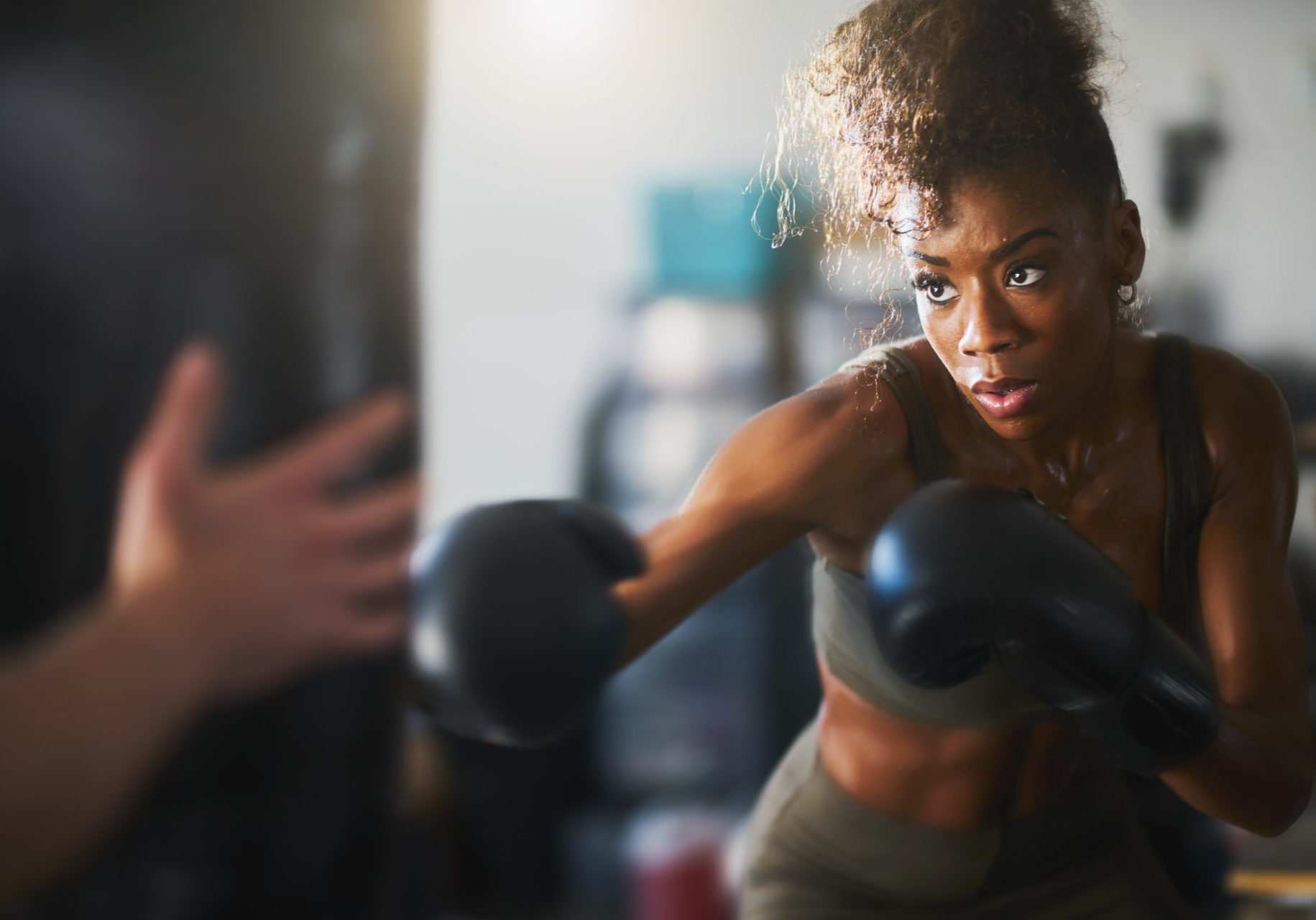 Woman Punching Boxing Bag |Why You Should Add Boxing To Your Workout Regimen | X3 Sports